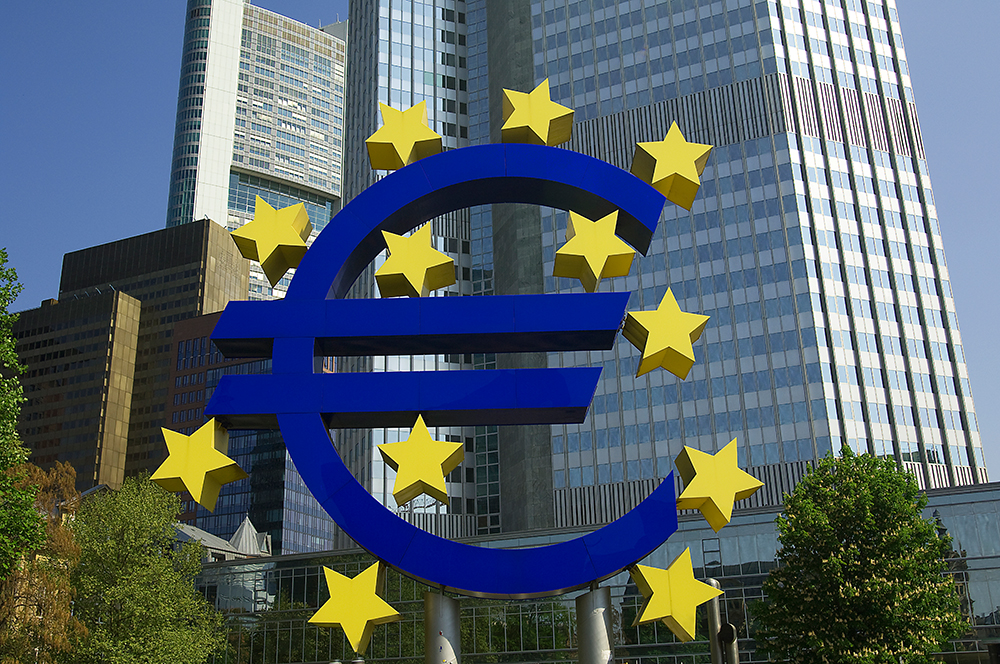 Investor greed putting financial stability at risk, warns ECB / Euro Sculpture -And ECB Headquarter / The Telegraph
